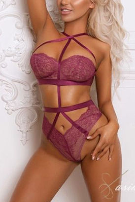 Luxury petite blonde London escort girl in a hot pose