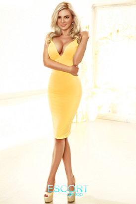 Busty blonde in a sexy yellow dress and high heels