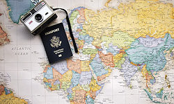 Image of a map with an old camera and passport placed on it