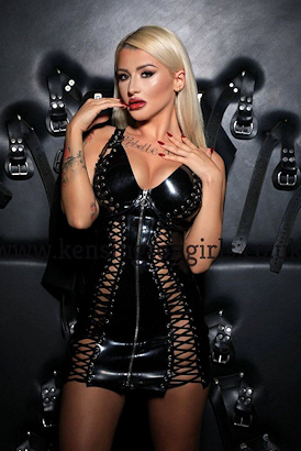 Peroxide blonde in fetish gear ready to be tied up